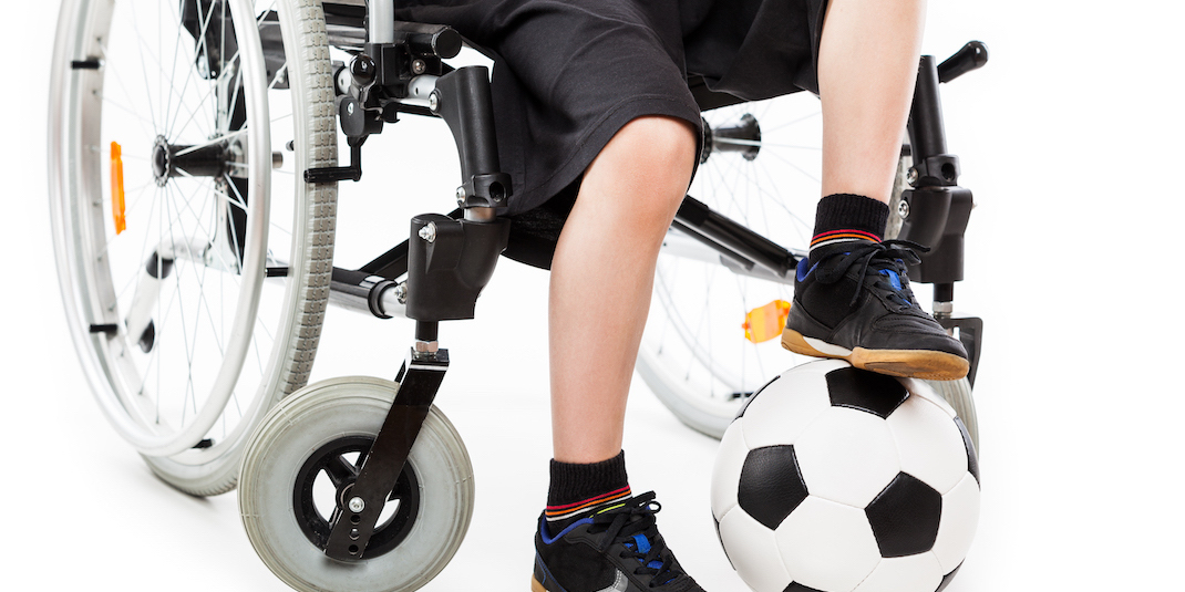 Child in a wheelchair with a soccer ball