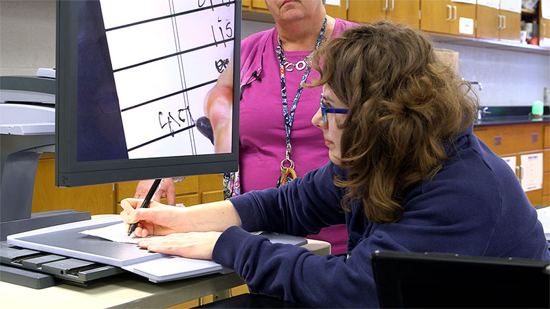 A young woman using assistive technology