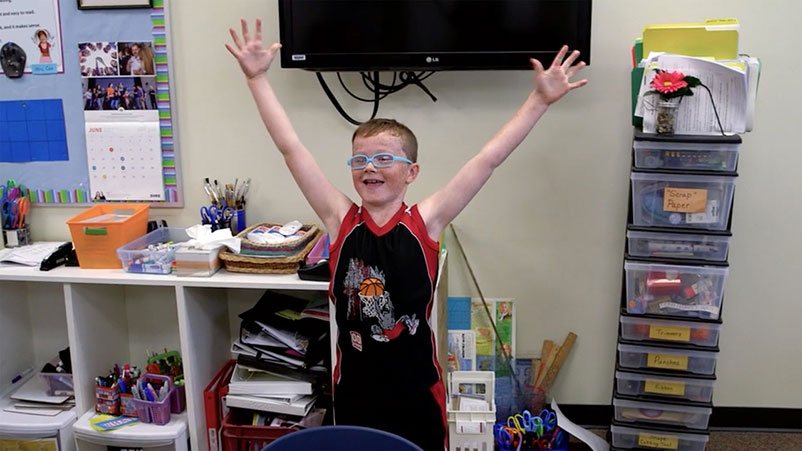 A boy with his arms out in excitement
