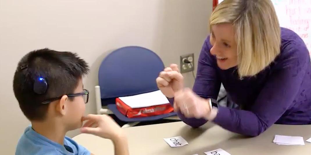 TeacherSigningWithStudent.jpg